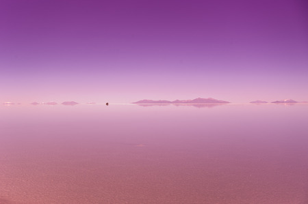 salar de uyuni: Salar de Uyuni in Bolivia, sunrise, car on a background Stock Photo