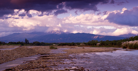 bathymetry: The mountain river in Bolivia against the backdrop of storm clouds, the beginning of the rainy season.