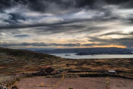 peruvian ethnicity: Puesta de sol en la isla de Amantani, Per�. Foto de archivo