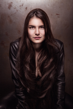 Girl in leather pants and jacket photo