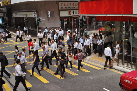 hurrying: People are hurrying to work. Hong Kong Special Administrative Region of the Peoples Republic of China, is a city on the southern coast of China at the Pearl River Estuary and the South China Sea