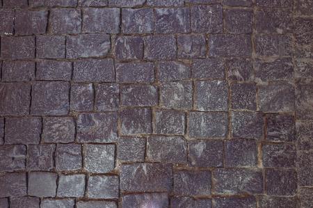 cobblestone: Cobbled Road. granite, cobblestone. The pavement.
