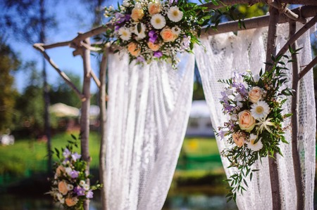 wedding tent: wedding arch made ??wood decorated with flower