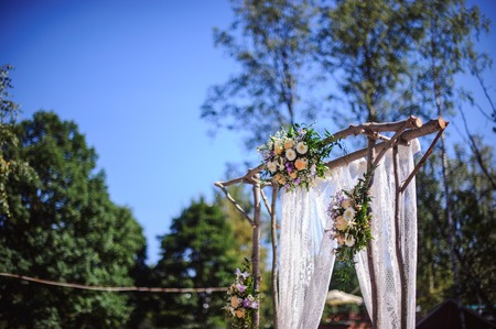 wedding tent: wedding arch made ??of wood, decorated with flowers