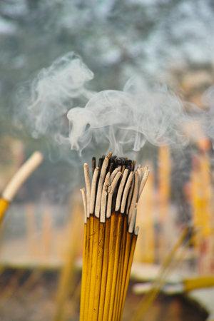 Smoldering incense sticks photo
