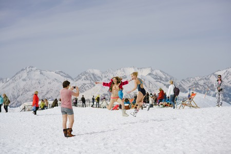 warren: SOCHI, RUSSIA-APRIL 2016: skiers in swimsuits jumping in front of camera Editorial