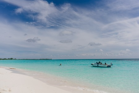 varadero: The boat in the waters of the Caribbean Sea and the view of the beach of Cayo Largo, Cuba out of the water Stock Photo