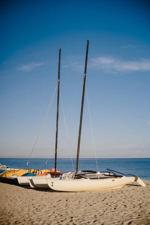 cana: Catamarans on the beach