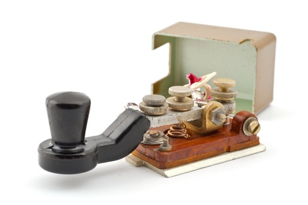 Morse code key on a white background