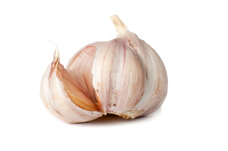 The ripened garlic on a white background