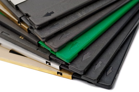 Corners of diskettes with arrows on a white background