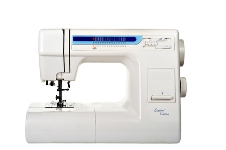 the household sewing-machine on a white background photo