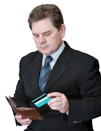 The man getting from a purse a credit card on a white background Stock Photo