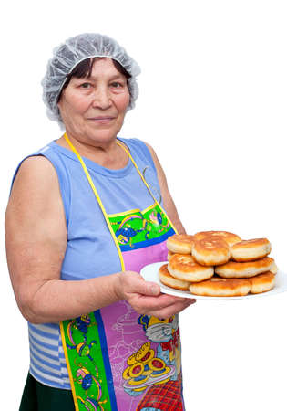 The woman with a dish of pies on a white background Stock Photo