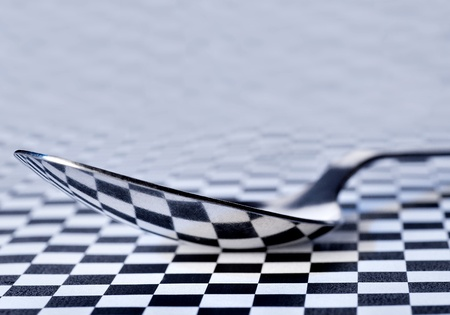 reflection of a chess field in a tablespoon