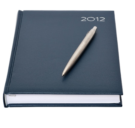 the daily log with a pen on a white background Stock Photo