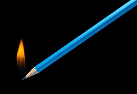 burning pencil Stock Photo