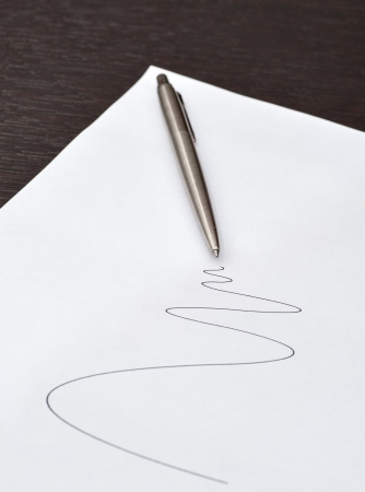pen lying on a sheet of paper with the drawn line