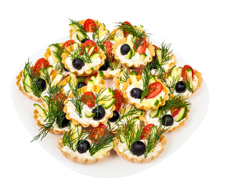 tortoletka with vegetables and cream it is isolated on a white background Stock Photo