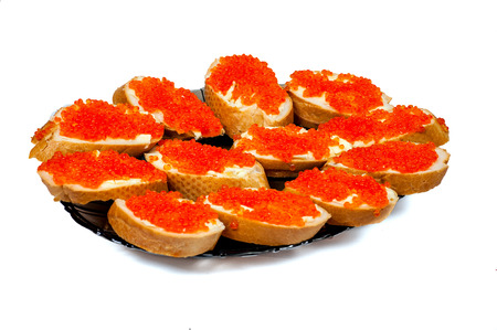 sandwiches with red caviar on a dish