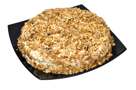 pie posyranny a nut crumb on a black dish