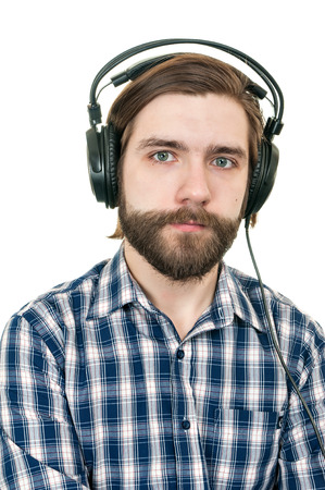 the man with a beard in earphones on a white background Stock Photo