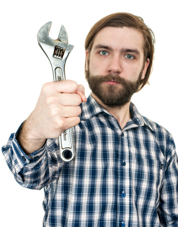 the young bearded man a holding wrench in hand it is isolated on a white background photo