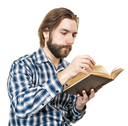 the man with a beard reads the book, is isolated on a white background