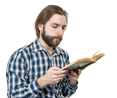 the man with a beard reads the book is isolated on a white background