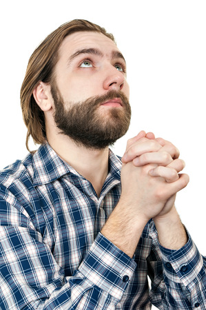 the young man with a beard prays to god, is isolated on a white background