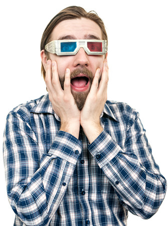 the young man with a beard, looks through stereo glasses, is isolated on a white background