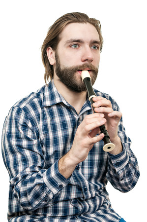the young man playing on a recorder, it is isolated on a white background
