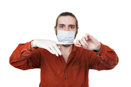 the young man removing a medical rubber glove, it is isolated on a white background Stock Photo