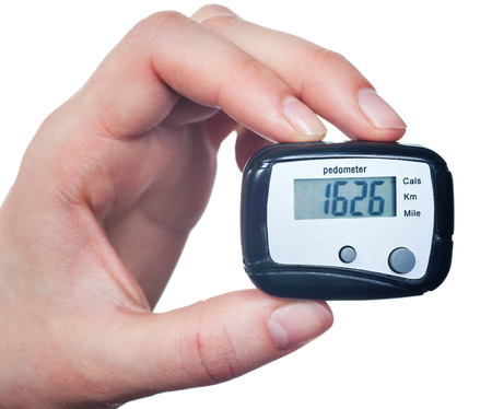 Hand  Holding Digital Pedometer On White Background