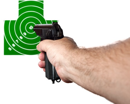 Hand with a gun aimed at the target isolated on a white background