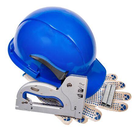 blue helmet, gloves, furniture stapler, and staples for stapler isolated on white background