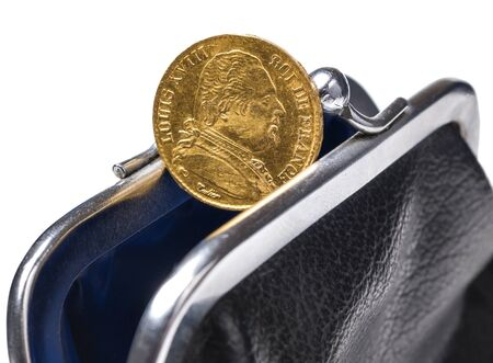 20 francs gold coin in an open purse is isolated on a white background Stock Photo