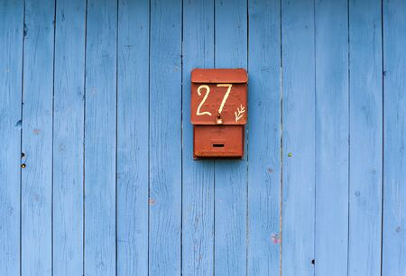 blue wooden fence with mailbox in the foreground Stok Fotoğraf