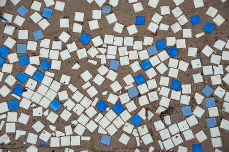 photo background of multicolored square mosaic on concrete