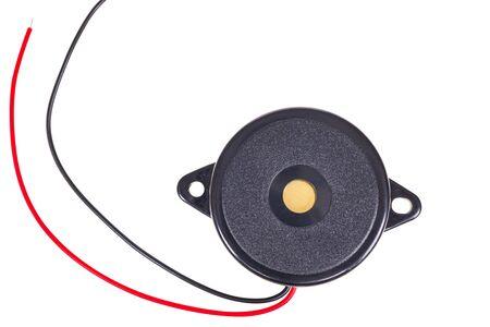 Thin passive electronic piezo buzzer on a white background Stok Fotoğraf