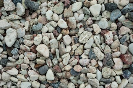 photo background of rounded pebbles and granite