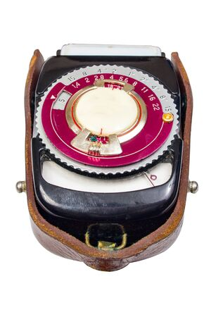 Vintage photo light meter close up isolated over white background