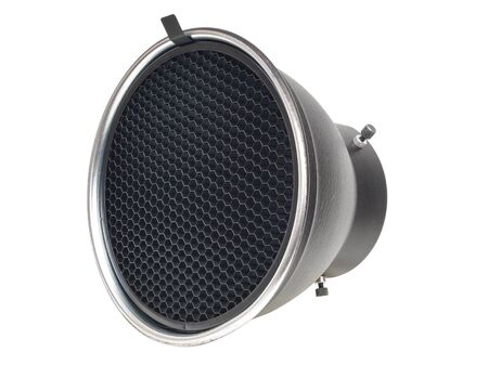 Reflector with honeycomb grid accessory for studio strobes and flashes The honeycomb grid helps to focus contain the light to a narrower more defined area of coverage. Isolated on 255 White Background