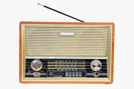 Old-fashioned vintage radio isolated on a white background