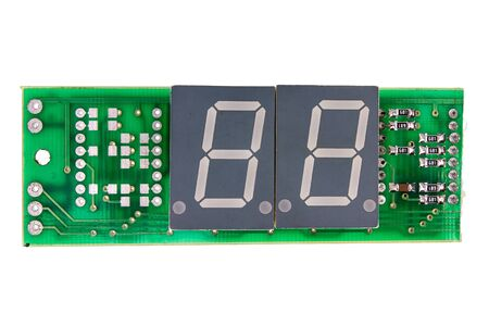 seven segment indicators on a green circuit board isolated on white background