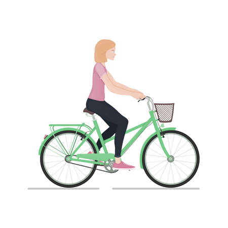 Young girl rides a bike isolated on white background