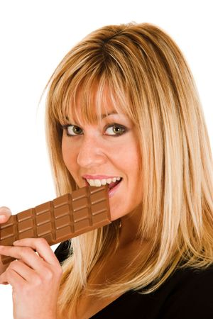 ni�a comiendo: muchacha joven que come el chocolate