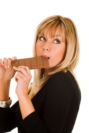 savour: young girl eating chocolate Stock Photo