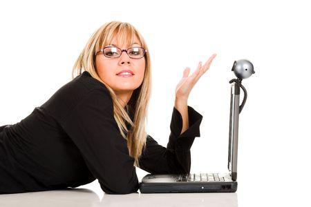 telecommute: A businesswoman using notebook and webcam