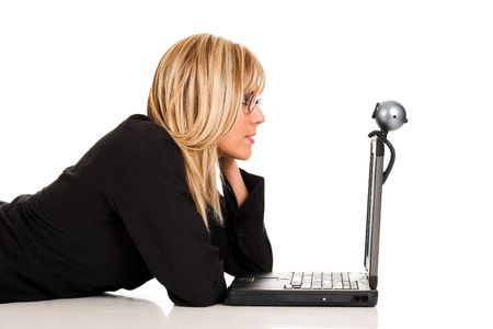 A businesswoman using notebook and webcam photo